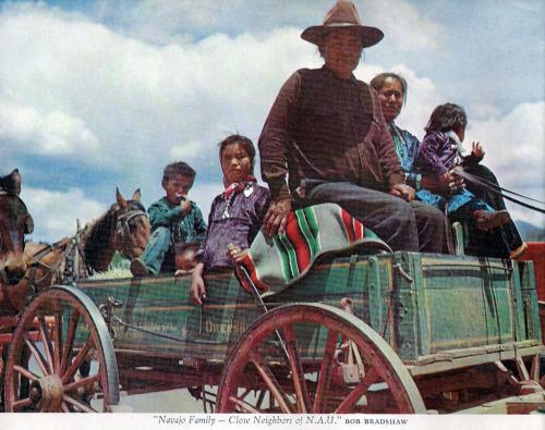 A Navajo family on a Babbitt wagon.