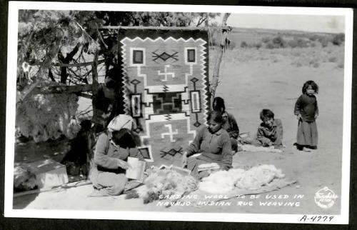 Carding wool to be used in Navajo Indian rug weaving.